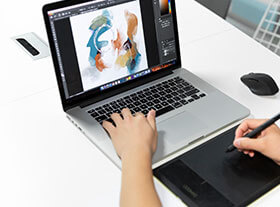 Designers use laptop to draft the design.